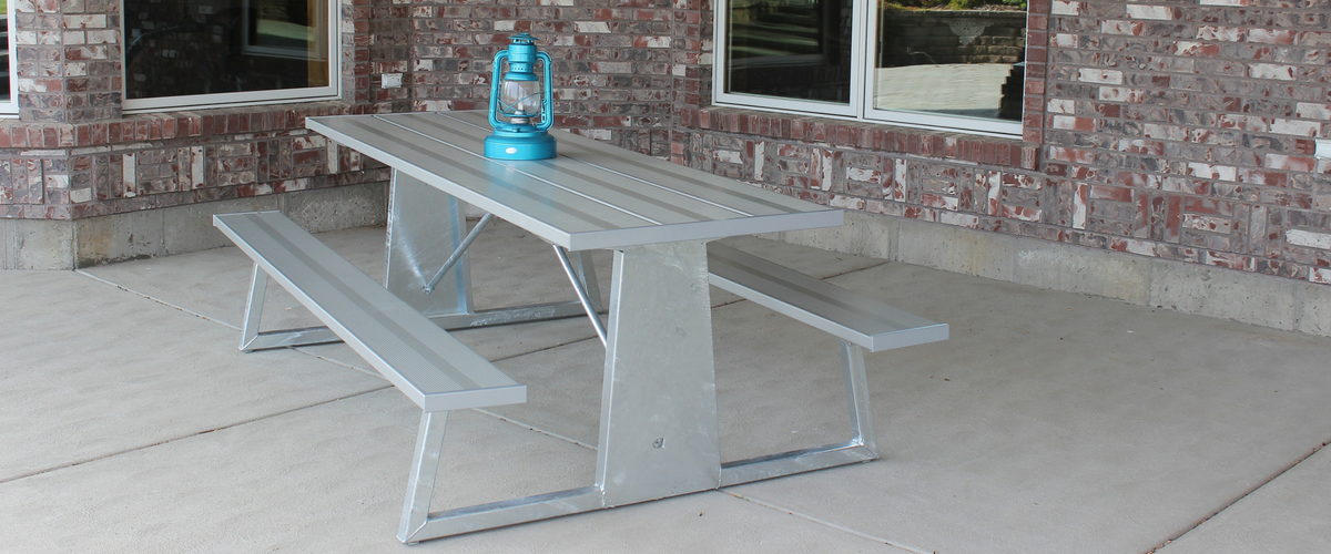 ANODIZED SILVER SPRUCE PICNIC TABLE ON THE BACK PORCH